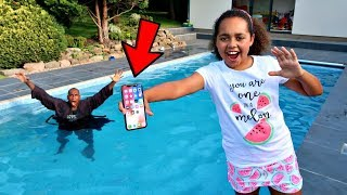 MY DAD'S iPhone X IN OUR SWIMMING POOL PRANK!! thumbnail