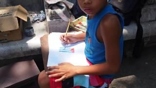Niño cubano dibujando bandera de su país. CUBA