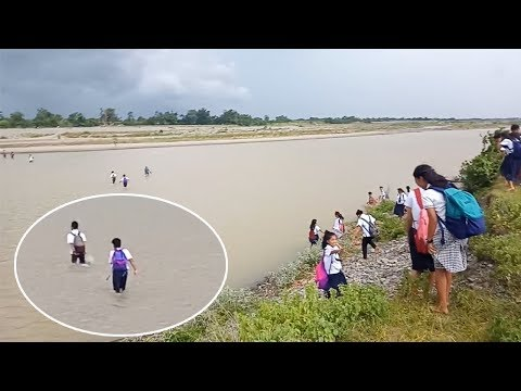 Schoolchildren Wade Through River To Reach School