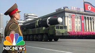 Kim Jong Un Presides Over Huge Military Parade On Eve Of PyeongChang Olympics | NBC News