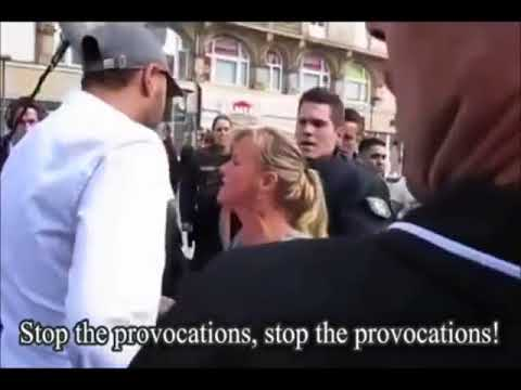 A Young German girl stands against radical muslims Frankfurt Germany thumbnail