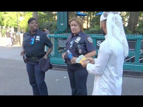 ARAB GUY GIVES POLICE FREE MONEY!!