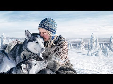 Tinja and her dogs from the Lappish wilderness