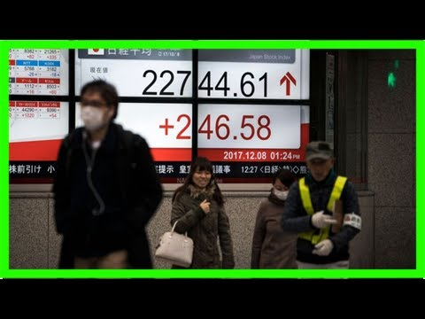 Tokyo stocks close up on weaker yen, strong gdp