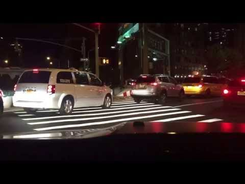 Manhattan, NY (take 697): 2 import SUVs running the red light over the pedestrian cross-walk