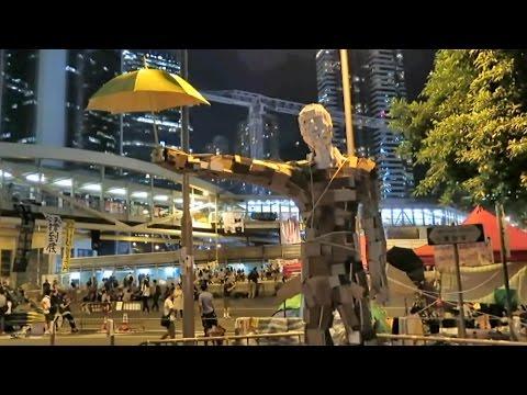 "Hong Kong Protests. The John Lennon Wall, Umbrella Man Statue and ""689"" under the Feet"