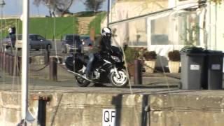 Motorcycle Falls Onto Boat