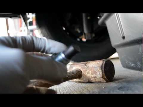 nissan rogue 2009 how to change axel shaft