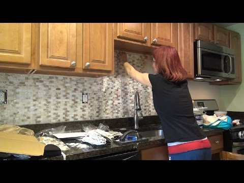 installing kitchen backsplash tiny kitchens diy installation - mother of pearl tile ...