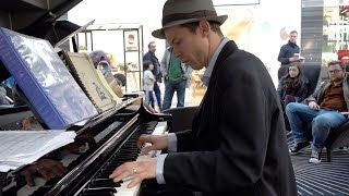 Musician entertains shoppers playing 1950s style Rock n' Roll on public piano in Aberdeen