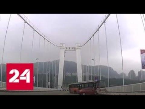 В Китае автобус упал в реку из-за пропустившей остановку пассажирки - Россия 24