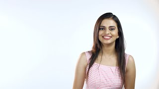 Attractive Indian female smiling and looking towards the camera - White background