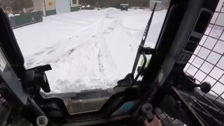 Plowing snow with our New Holland L230 skidsteer