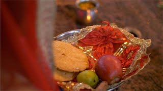 Closeup shot of a married woman hands doing Karwa Chauth puja - Indian festival