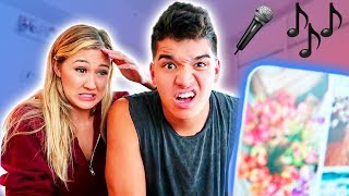 REACTING TO OUR FIRST SONG!