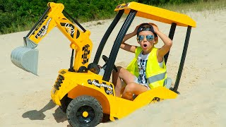 Artem plays with Tractor and Big Cars on the beach