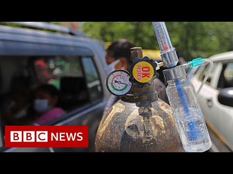 Indian temple offers drive-through oxygen amid Covid crisis - BBC News