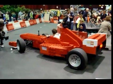 Full size lego model ferrari Formula One F1 race car out of lego bricks driving Zwolle Netherlands