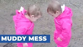 Twins Play In Mud