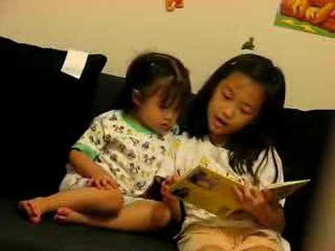 Ranita reading to Katrina