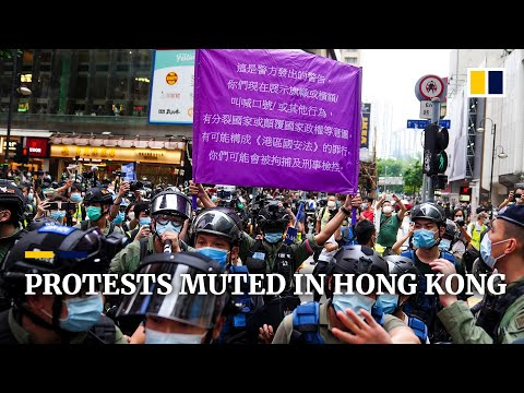 Massive police presence blunts Hong Kong protests on China's
