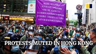 Massive police presence blunts Hong Kong protests on China's National Day
