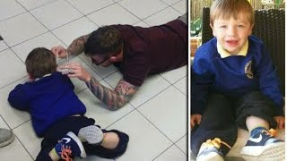 U.K Barber lay down on floor to cut the hair of Autistic Boy who was too frightened to sit to chair