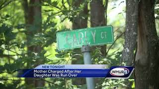 Mother charged after her child was run over