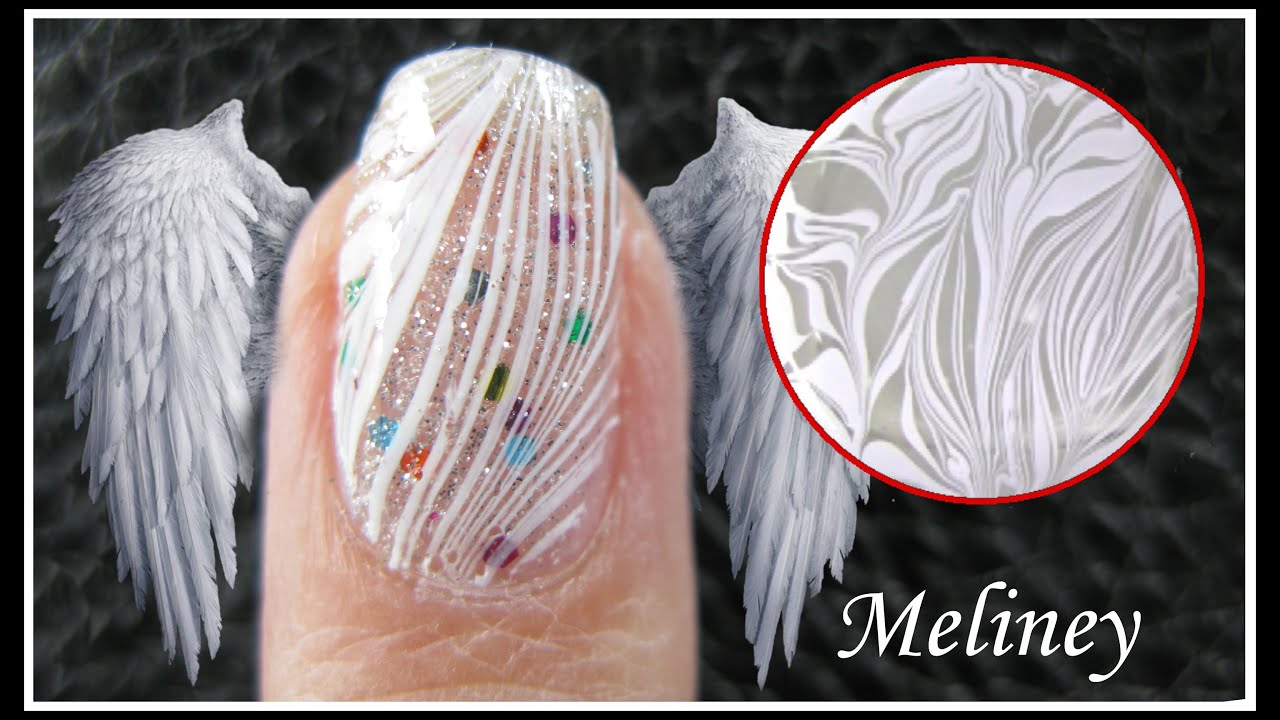 water marble nail art white feather