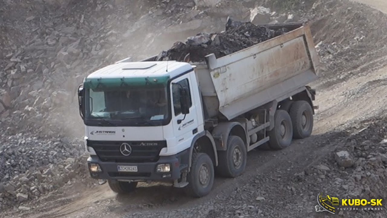 Mercedes benz actros dump truck driving at the quarry for Mercedes benz dump truck