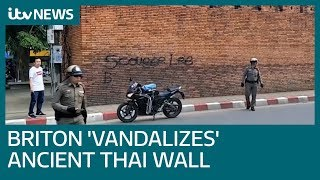 British tourist faces 10-year jail term for 'spray-painting' ancient Thai wall | ITV News
