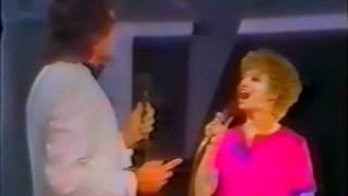Elaine Paige and David Essex sing
