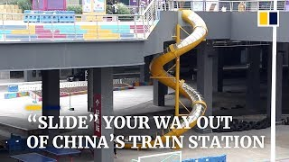 train station in china installs 32 foot high slide for commuters
