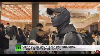 Chinese official attacked in UK as HK violence spreads