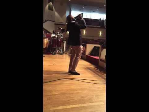 Clifton Ross III sings
