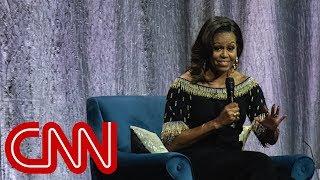 Michelle Obama compares Trump to a 'divorced dad'