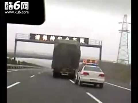 Chinese police chasing a truck on the expess way of Beijing to Ji'nan