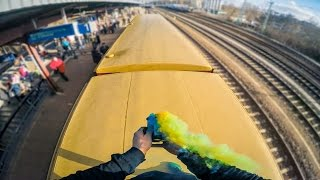 This is highly fucking dangerous  please dont try to recreate this Some random guys decided to train surf and smokebomb some trains in Berlin and get some