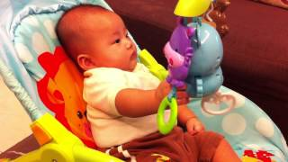 baby reaching toys at 3months