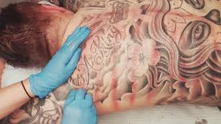 What coining or Kerokan / gua sha look like on fully body tattoos