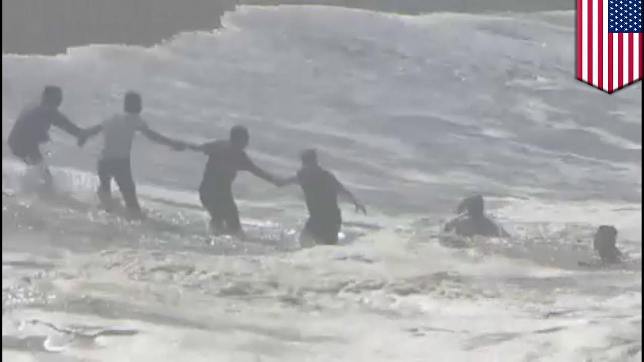 Faith in humanity restored: Beachgoers form human chain to save stranded swimmer