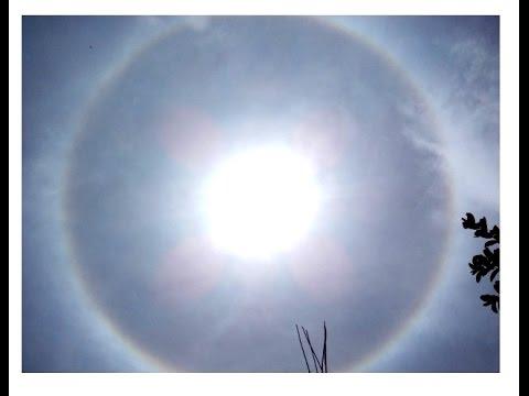 Halo Aureola gigante en el SOL y arco iris  asombroso en el cielo  22/08/14