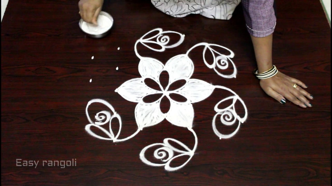 Easy Rangoli Designs With 7 To 4 Interlaced Dots