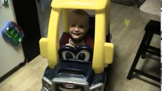 Cute kid playing with his Little Tikes Truck