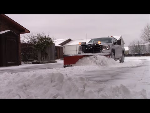 Plowing snow in a small parking lot