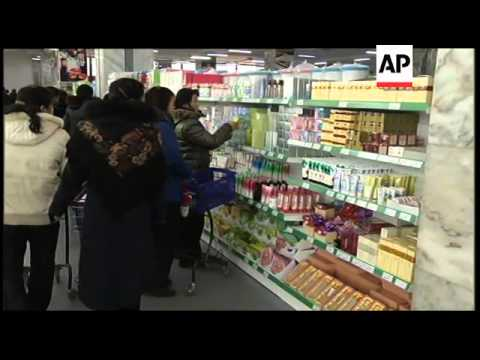North Korean shoppers enjoy mall experience