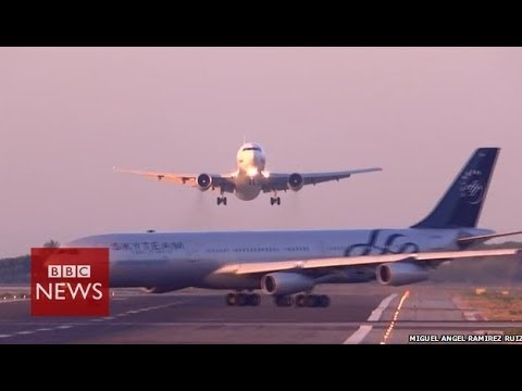 Planes seconds from disaster at Barcelona airport - BBC News