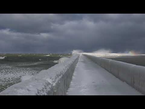 Waves crash against Port Austin breakwater