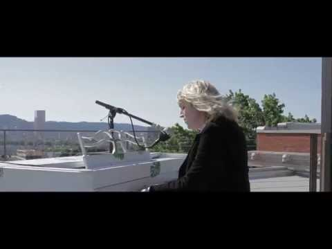 """Sally Seltman performs """"Dancing in the Darkness"""" on top of Revolution Hall"""