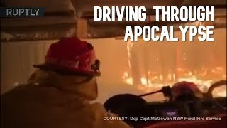 Firefighters driving through an apocalyptic inferno in Australia
